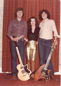 The singer Donna with two vintage electric guitars