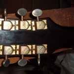 Headstock of an unknown Les Paul-style electric guitar