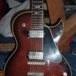 Front of the body of an unknown Les Paul-style electric guitar